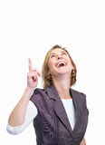Cheerful mature woman pointing upwards Royalty Free Stock Images