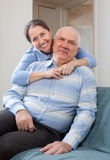 Cheerful mature woman with smiling husband Stock Image