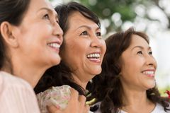 Cheerful mature women. Close-up portrait of cheerful mature women looking up, selective focus Royalty Free Stock Photos