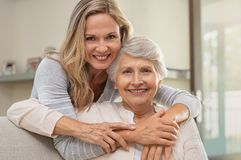 Woman hugging mother with love stock photo