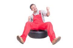 Cheerful mechanic acting like a winner Royalty Free Stock Photos