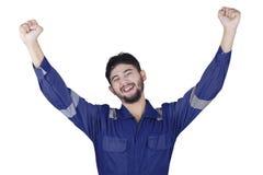 Cheerful mechanic celebrate his success Stock Photos