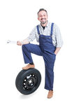 Cheerful mechanic with tools posing on overalls Stock Images