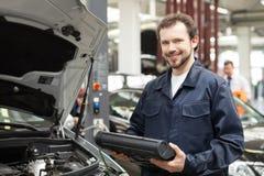 Cheerful mechanic. Stock Images