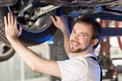 Cheerful mechanic. Royalty Free Stock Images