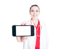 Cheerful medic holding mobilephone. With blank screen and text space in closeup isolated on white background Stock Photography