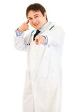 Cheerful medical doctor showing contact me gesture Royalty Free Stock Photography