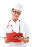 Cheerful medical doctor woman taking notes Stock Photos
