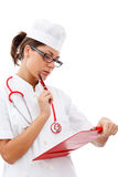Cheerful medical doctor woman taking notes Royalty Free Stock Photo