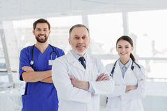 Cheerful medical team posing with confidence Stock Photos
