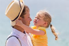 Cheerful man with kid close-up portrait outdoors royalty free stock photo