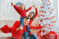 Playful happy family celebrating Christmas Stock Photo
