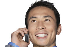 Cheerful mid-adult businessman using cell phone against white background Stock Photo