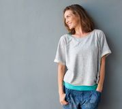 Cheerful Mid Adult Woman Smiling And Looking To The Side Royalty Free Stock Photography