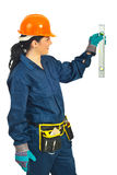 Cheerful mid adult worker woman measure Royalty Free Stock Images
