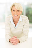 Cheerful mid age woman stock photography