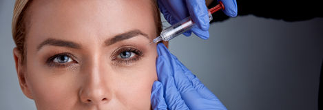 Free Cheerful Middle Age Woman Is Getting Botox Procedure Royalty Free Stock Photography - 87369417