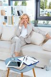 cheerful middle aged businesswoman talking on smartphone royalty free stock images
