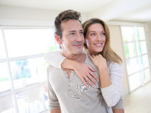 Cheerful middle-aged couple embracing each other at home Royalty Free Stock Photos