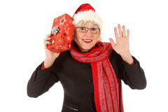 Cheerful middle aged santa woman, gift Royalty Free Stock Photography