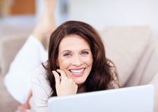 Cheerful middle aged woman with a laptop Royalty Free Stock Photography
