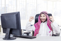 Cheerful middle eastern worker in the office Stock Photos
