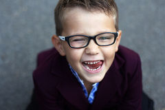 Cheerful and mischievous boy with glasses, close-up portrait, sc royalty free stock image