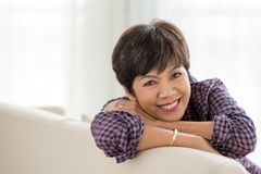 Cheerful mixed-race senior woman Stock Images