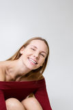 Cheerful model in burgundy dress Royalty Free Stock Images