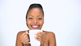 Cheerful model drinking coffee stock video