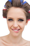 Cheerful model with hair curlers Royalty Free Stock Photography