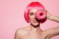 Cheerful model posing with doughnut Stock Photo