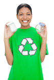 Cheerful model wearing recycling tshirt holding pots Royalty Free Stock Images