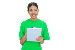 Cheerful model wearing recycling tshirt holding tablet Stock Photo