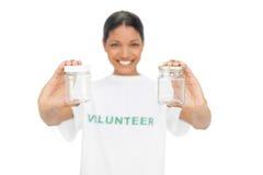 Cheerful model wearing volunteer tshirt holding pots Stock Photography