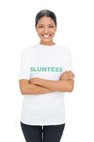 Cheerful model wearing volunteer tshirt posing Royalty Free Stock Images