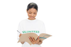 Cheerful model wearing volunteer tshirt writing Royalty Free Stock Photo