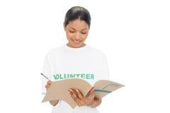 Cheerful model wearing volunteer tshirt writing Royalty Free Stock Photo
