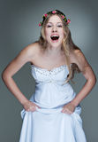 Cheerful model in white dress Stock Photography