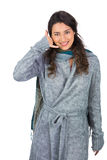 Cheerful model with winter clothes making phone call gesture Stock Images