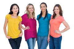 Cheerful models posing with hands on hips Royalty Free Stock Image