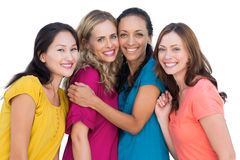 Cheerful models posing hugging each other Stock Photography