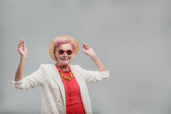 Cheerful modern middle aged female having fun time royalty free stock image