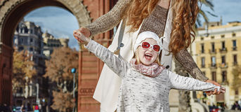 Cheerful modern mother and child in Barcelona, Spain Royalty Free Stock Images