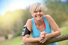 Cheerful modern senior woman relaxing after working out Stock Images