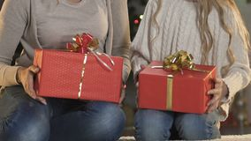 Cheerful mom and kid wrapping Christmas presents, preparation to holiday eve. Stock footage stock video