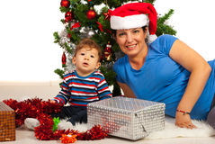 Cheerful mom and son under Xmas tree Stock Photos