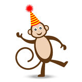 Cheerful monkey in a festive hat Royalty Free Stock Photos