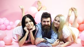 Cheerful morning concept. Man and women, friends on smiling faces lay pink background. Lovers in love happy together. Cheerful morning concept. Man and women stock video footage
