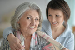 Cheerful mother and adult daughter stock image